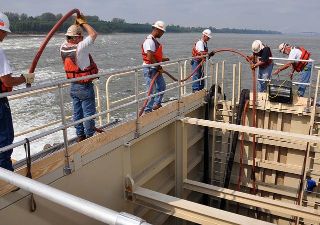 A repair crew at work on Dam 52 in 2013.